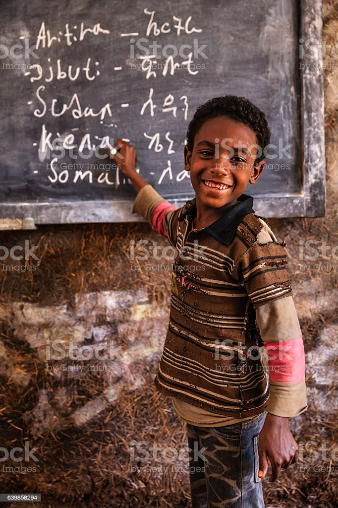 African young boy is learning Amharic language stock photo