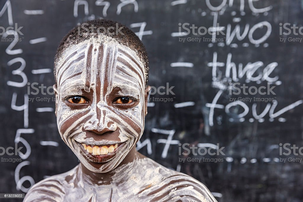African young boy is learning  English language, Karo tribe stock photo