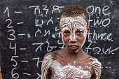 African young boy is learning  English language, Karo tribe
