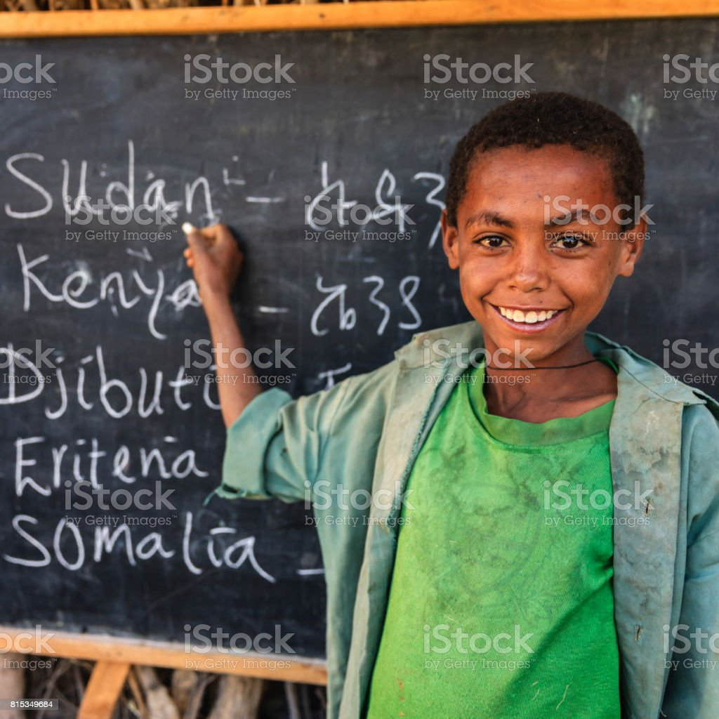 African young boy is learning  English language stock photo