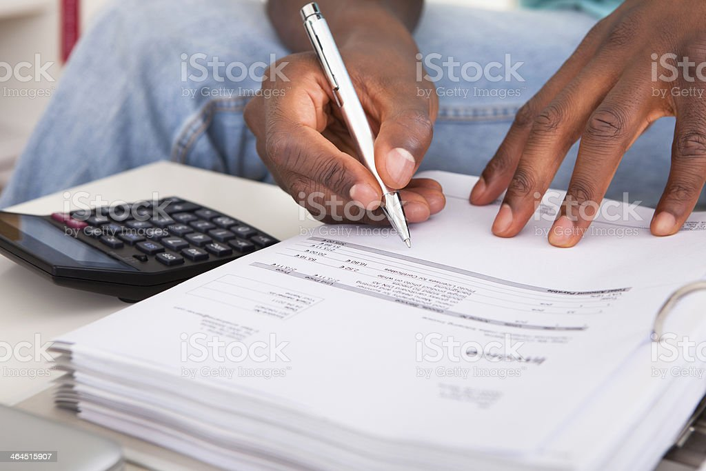 African Young Man Calculating royalty-free stock photo