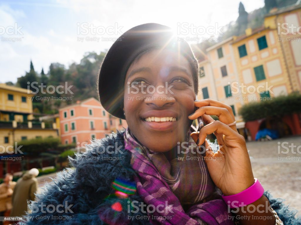 African young tourist woman in Portofino, Italy stock photo
