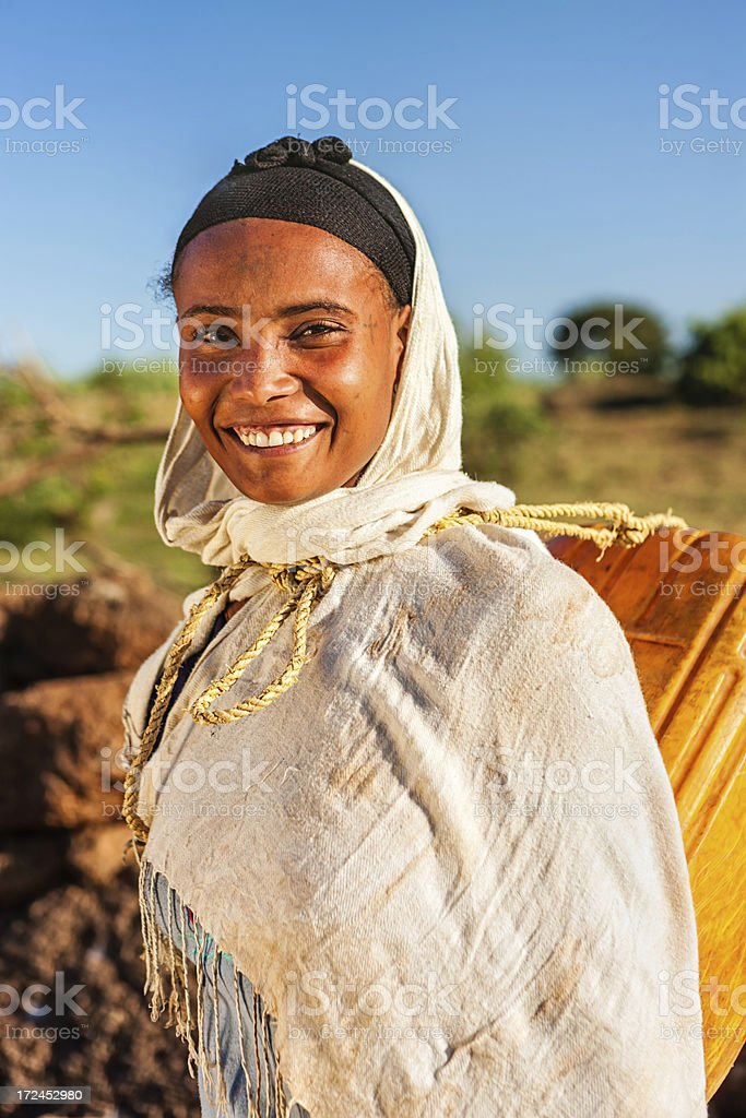 African young woman carrying water from the river, Ethiopia, Africa royalty-free stock photo
