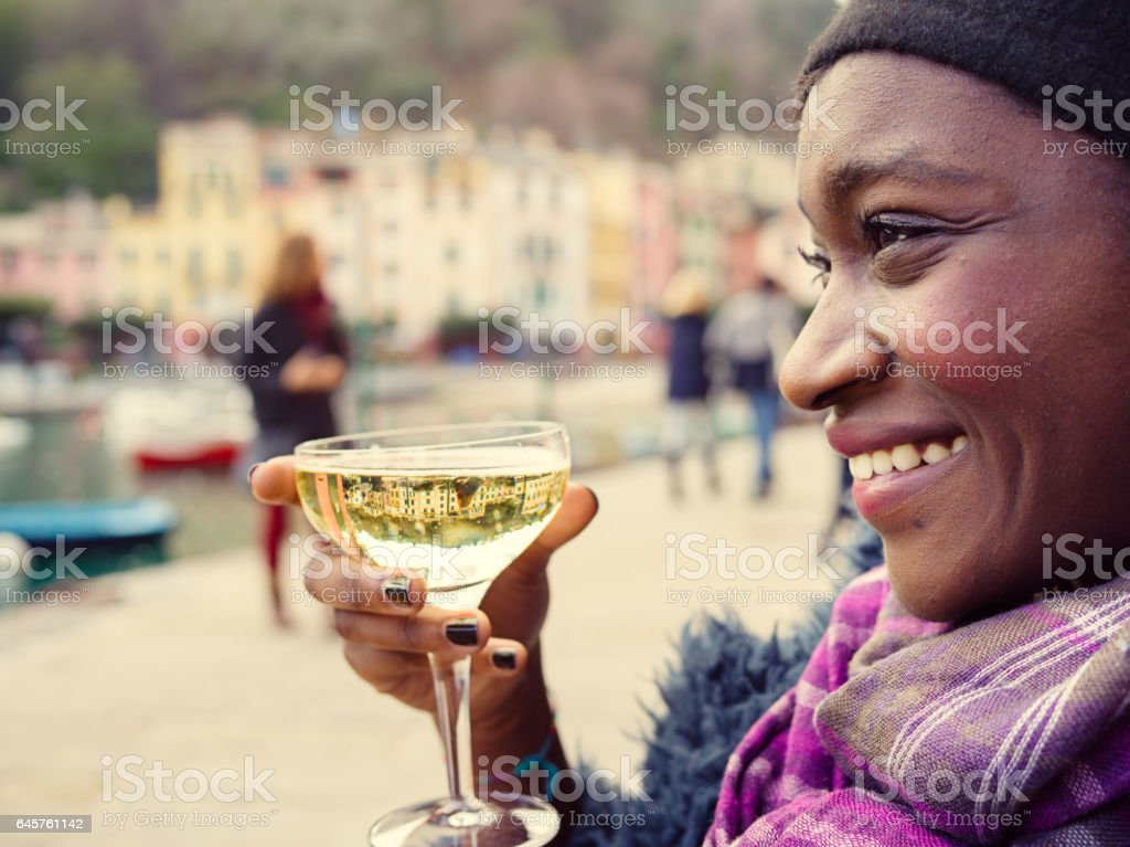 African young woman holding wine glass at Portofino stock photo