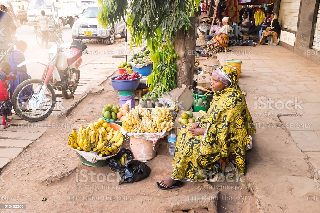 African young woman sells fuits on the street market stock photo