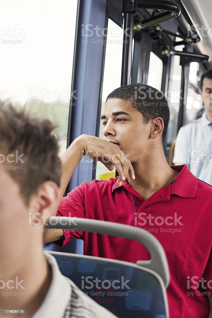 African-America young man travelling by bus. stock photo
