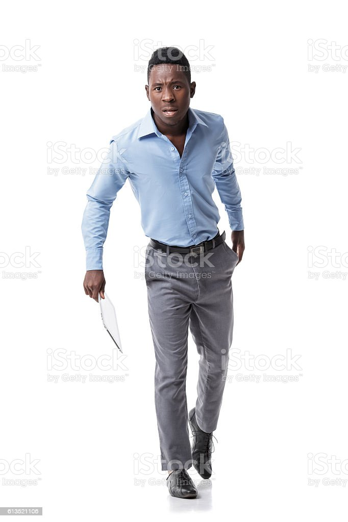 African-American business man running stock photo