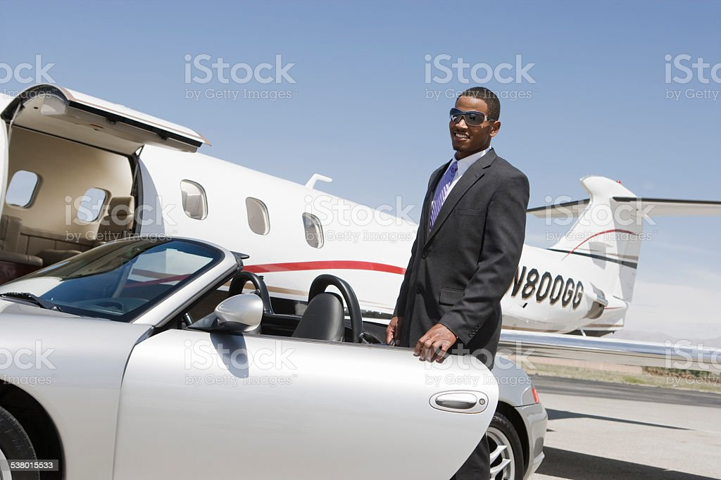 African-American businessman with airplane stock photo