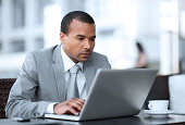 African-American businessman working on his laptop.