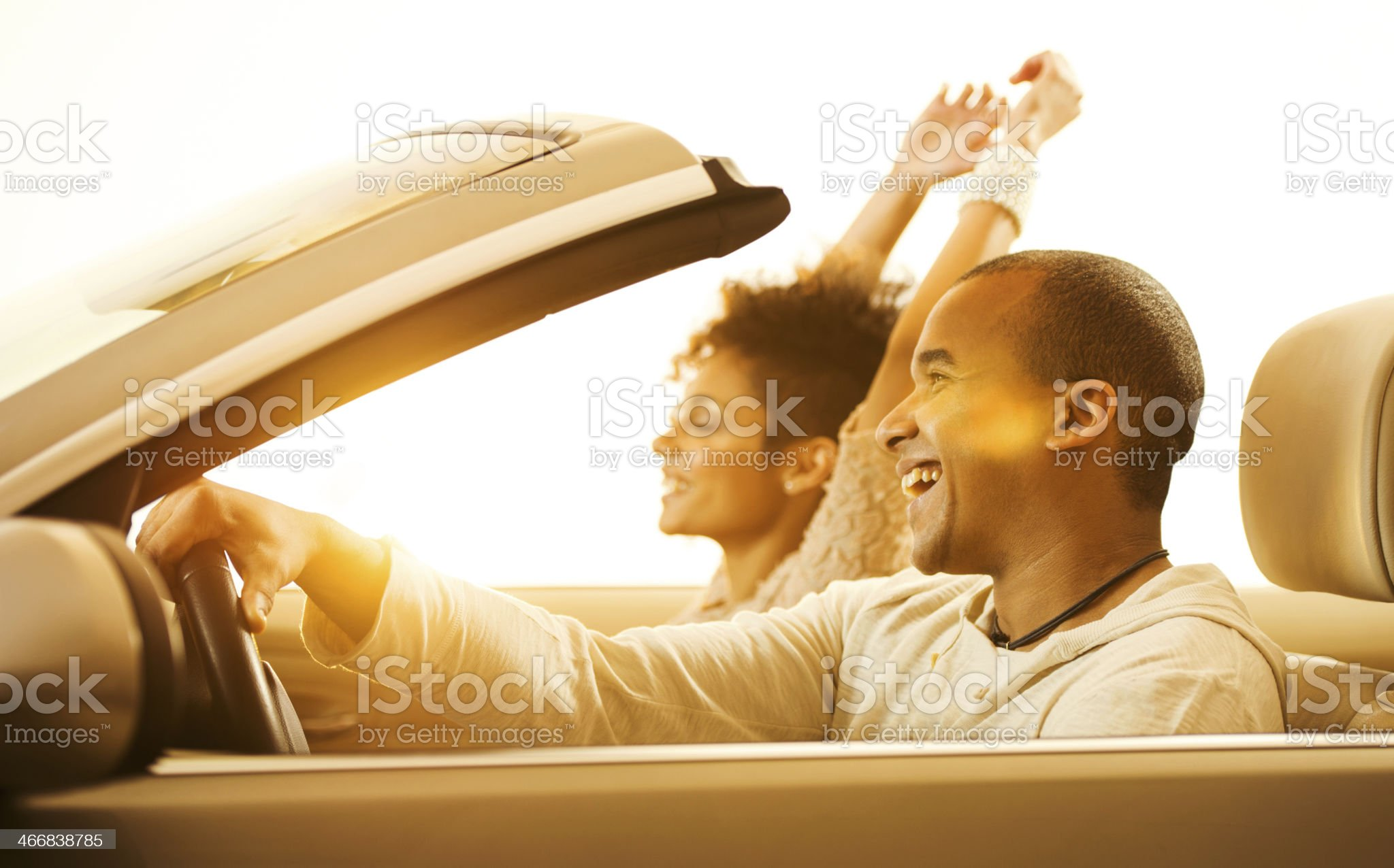 African-American couple in convertible car. royalty-free stock photo