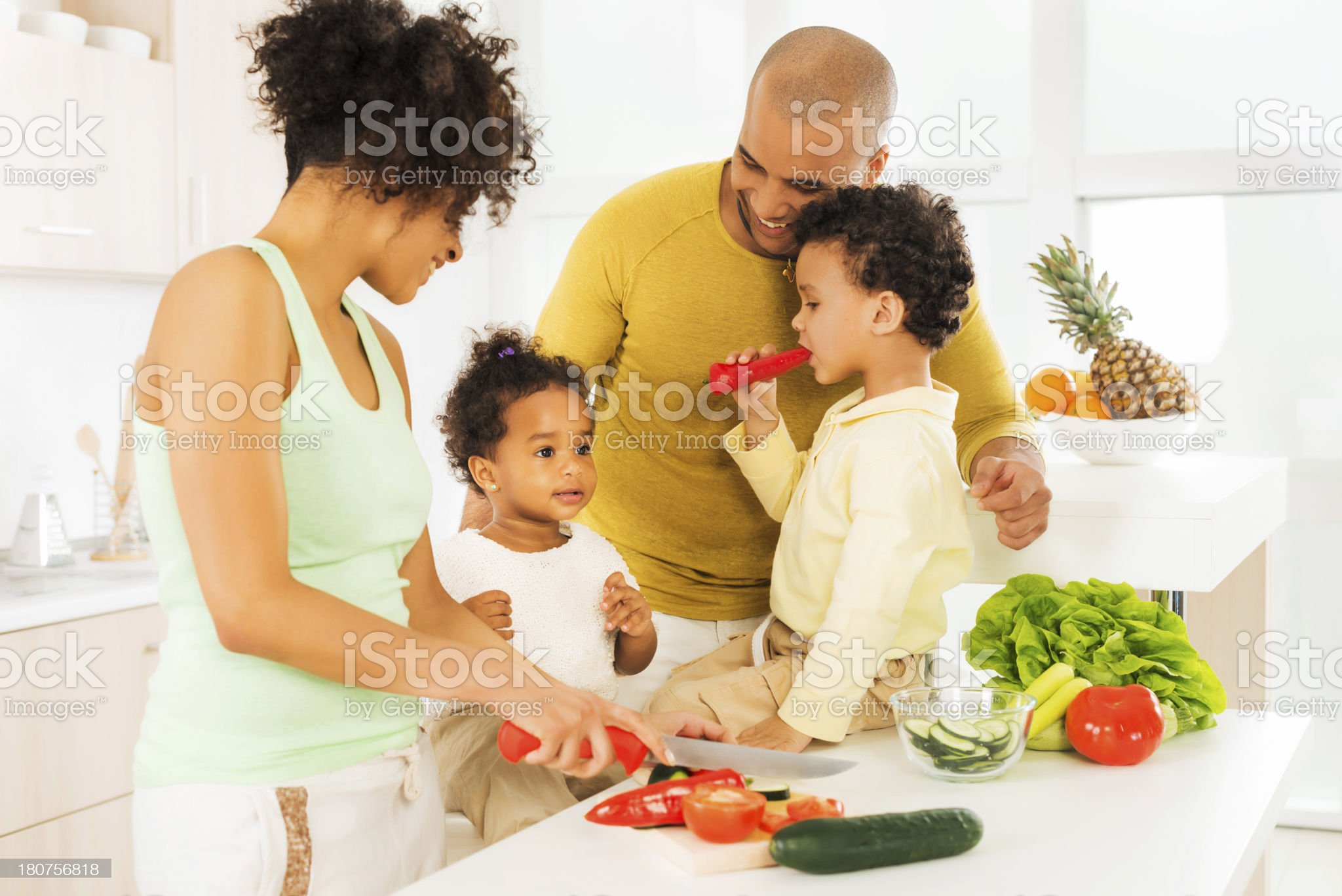 African-American family having fun in the kitchen. royalty-free stock photo