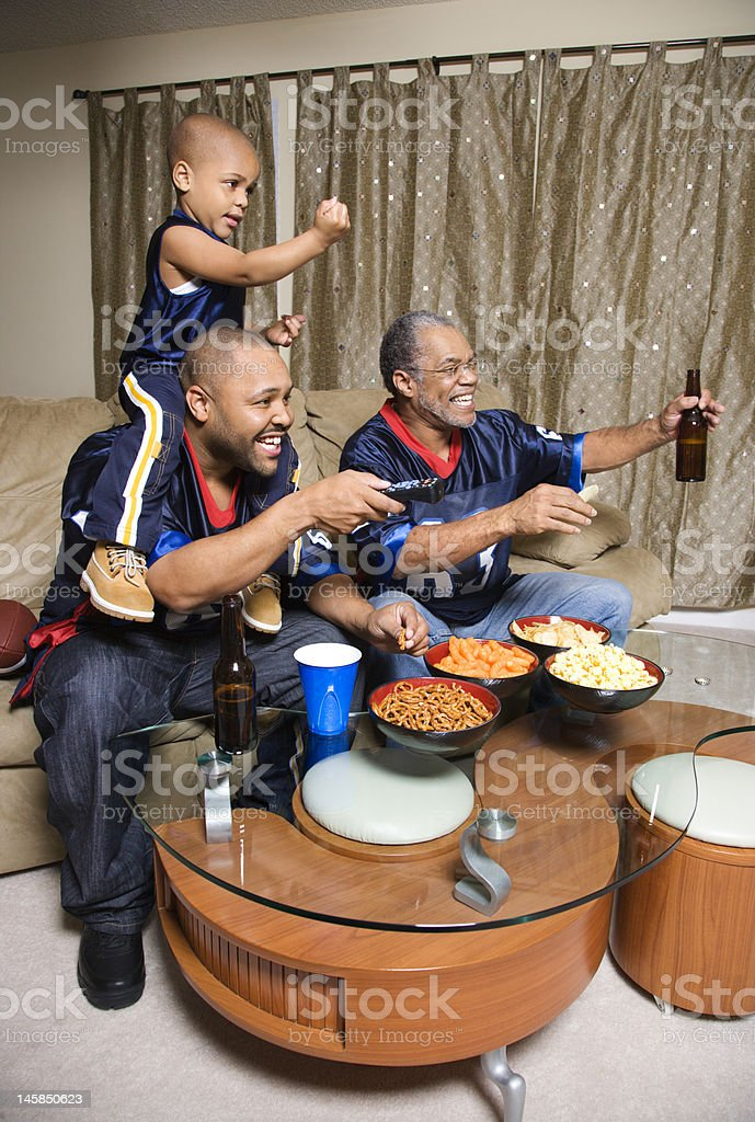 African-American family watching TV royalty-free stock photo