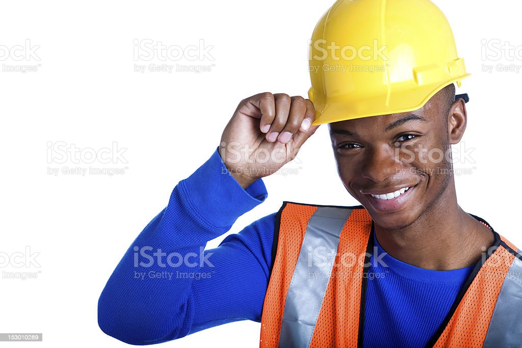African-American male construction worker tipping his hardhat royalty-free stock photo