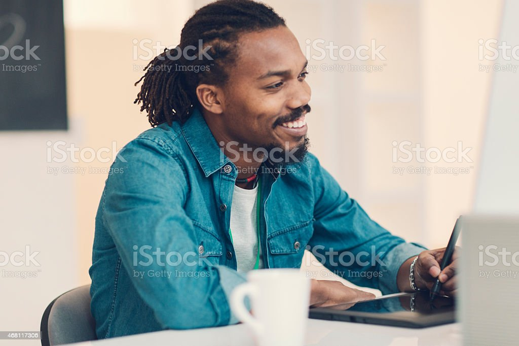 African-American Male Graphic Designer At Work. stock photo