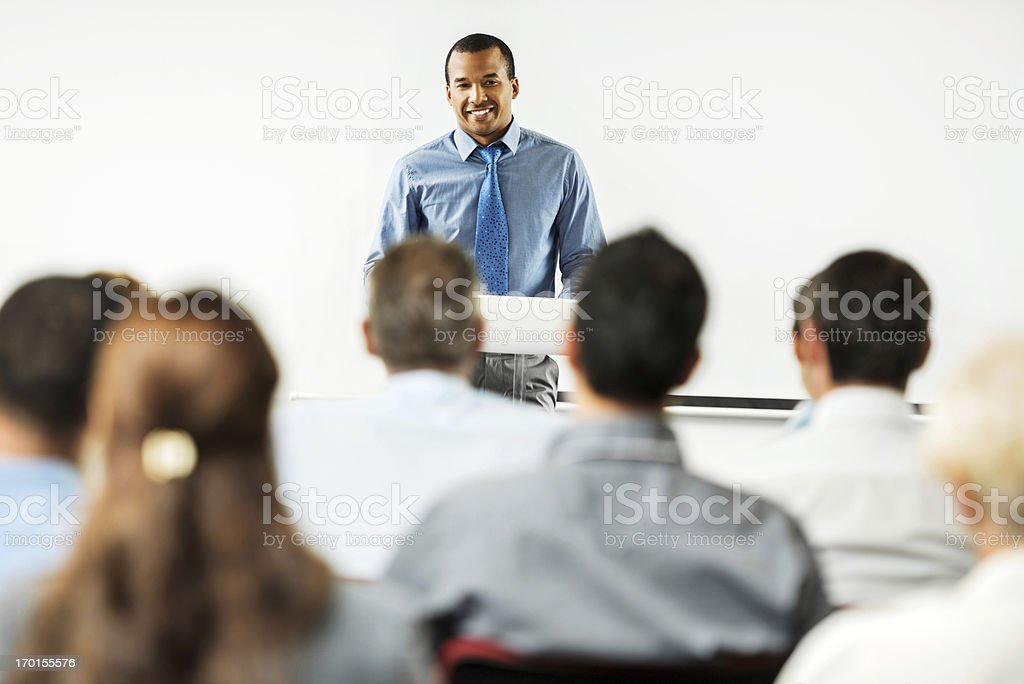African-American man having a public speech. stock photo