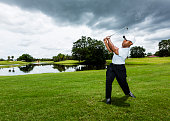 African-American Man hitting a shot on golf course