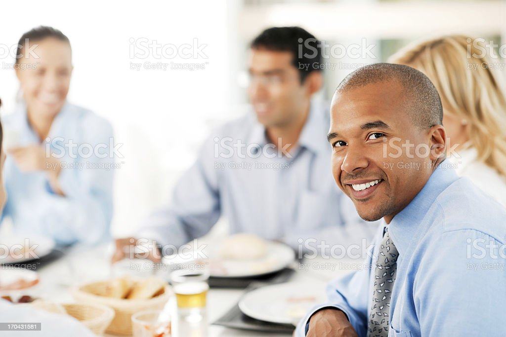 African-American man turning towards the camera in a restaurant. stock photo