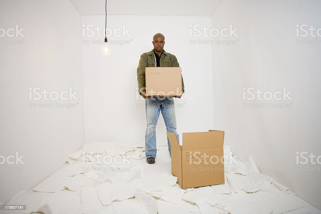 African-American man with boxes on moving day royalty-free stock photo
