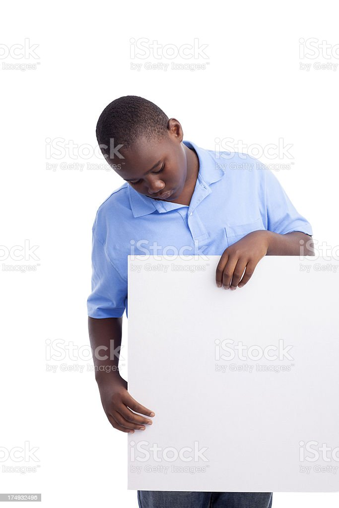 African-american teenage boy holding a blank sign royalty-free stock photo