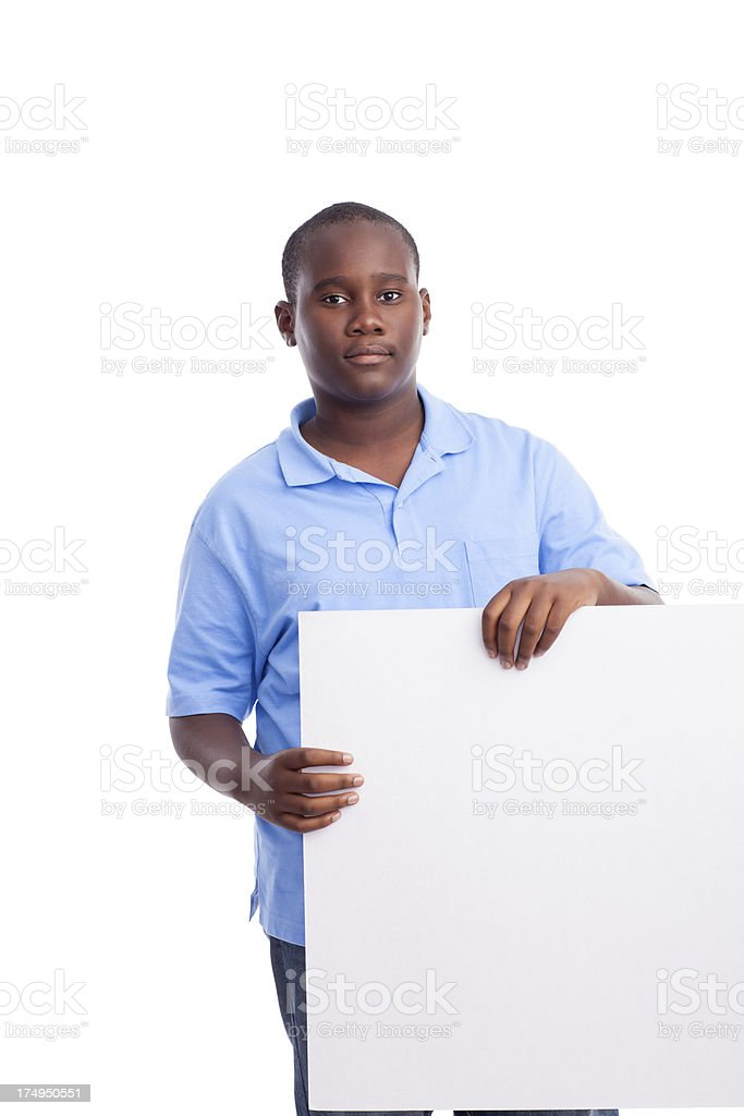 African-american teenage boy holding a sign royalty-free stock photo