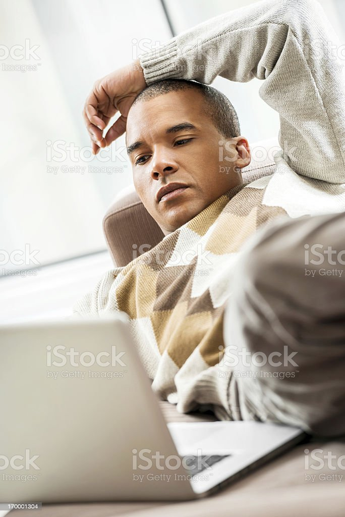African-American using laptop at home. royalty-free stock photo
