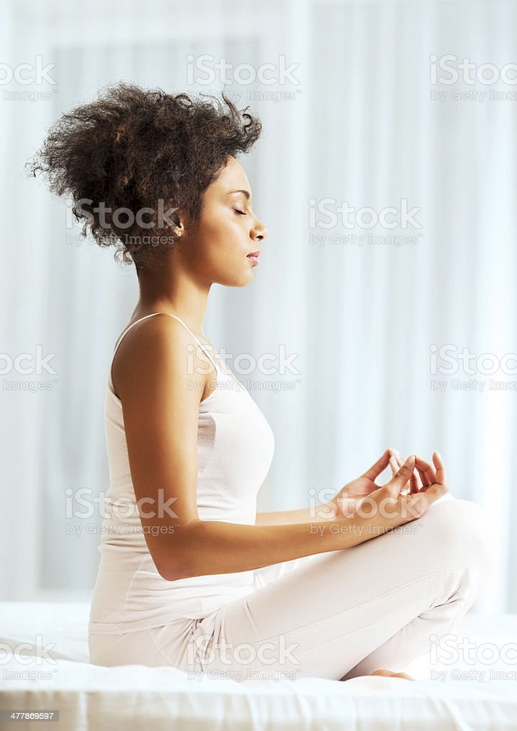 African-American woman doing yoga. royalty-free stock photo