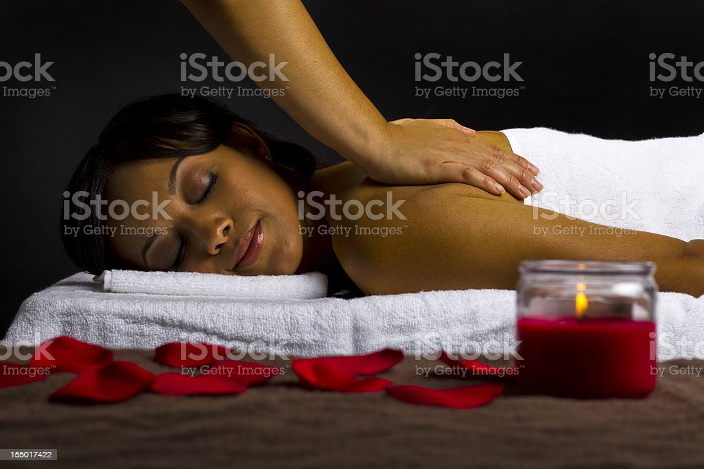African-American Woman Getting a Massage at a Spa royalty-free stock photo