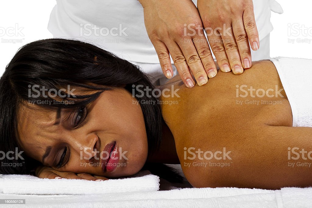 African-American Woman Getting a Painful Massage royalty-free stock photo