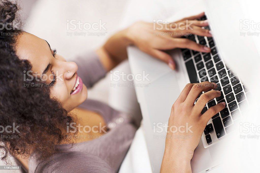 African-American woman using laptop. royalty-free stock photo
