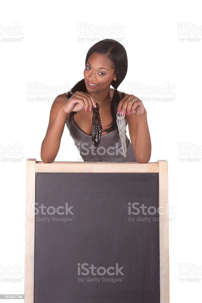 African-American woman with condoms by blackboard royalty-free stock photo