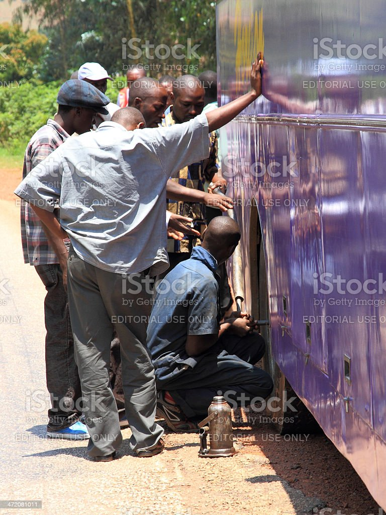Africans Change a Public Bus Tire royalty-free stock photo