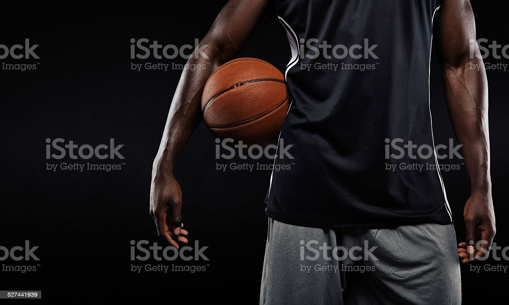 Afro american basketball player holding a ball stock photo