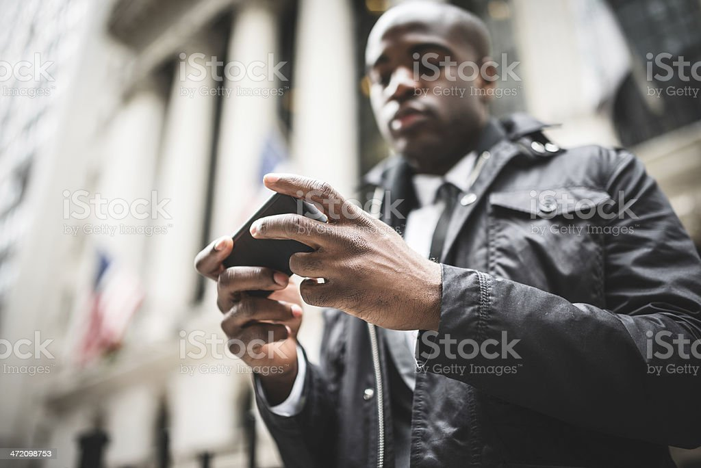 Afro american business man on the phone in wall street royalty-free stock photo