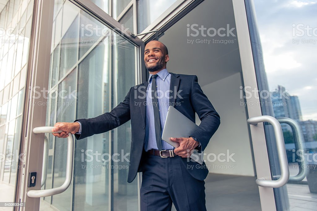 Afro American businessman with gadget stock photo