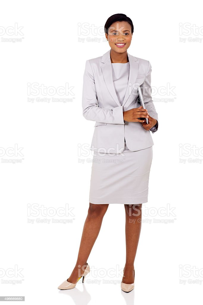 afro american businesswoman holding laptop computer stock photo