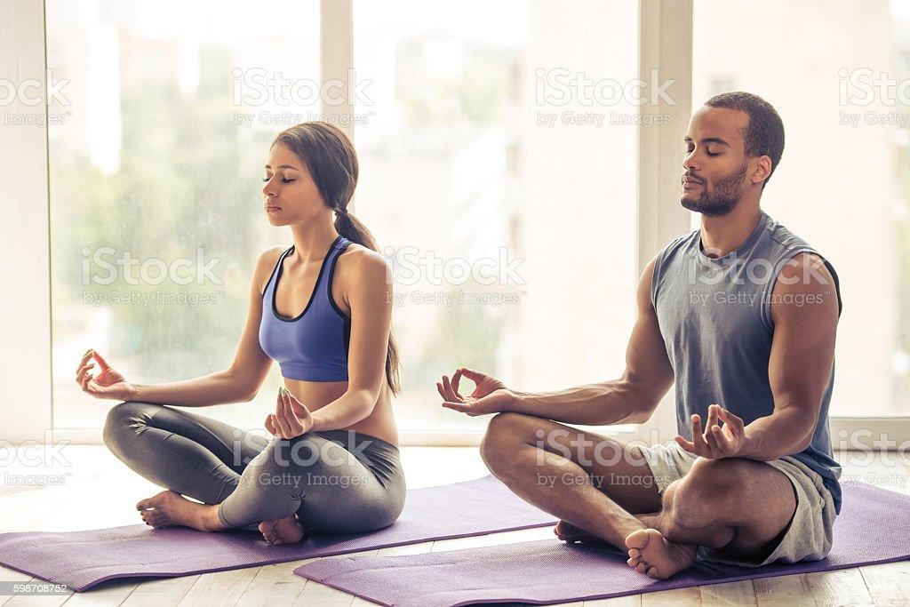 Afro American couple doing yoga stock photo