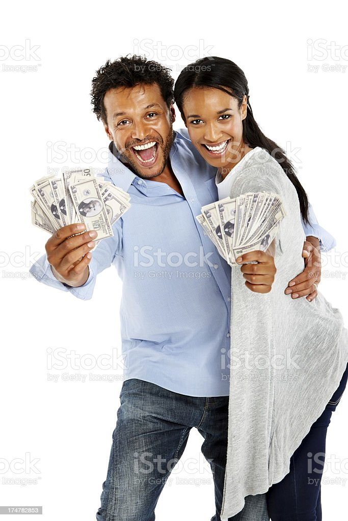 Afro American couple excited about money royalty-free stock photo