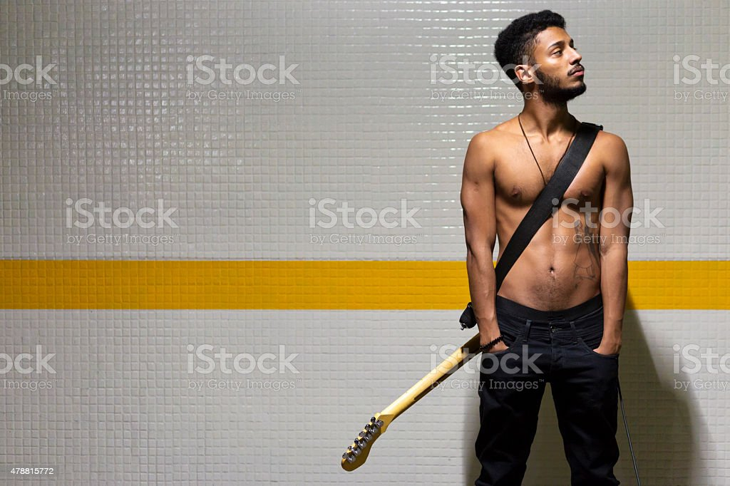 Afro American man with electric guitar stock photo