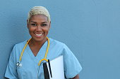 Afro american nurse standing at hospital ward