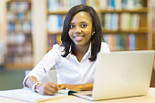 afro american student sitting in college library