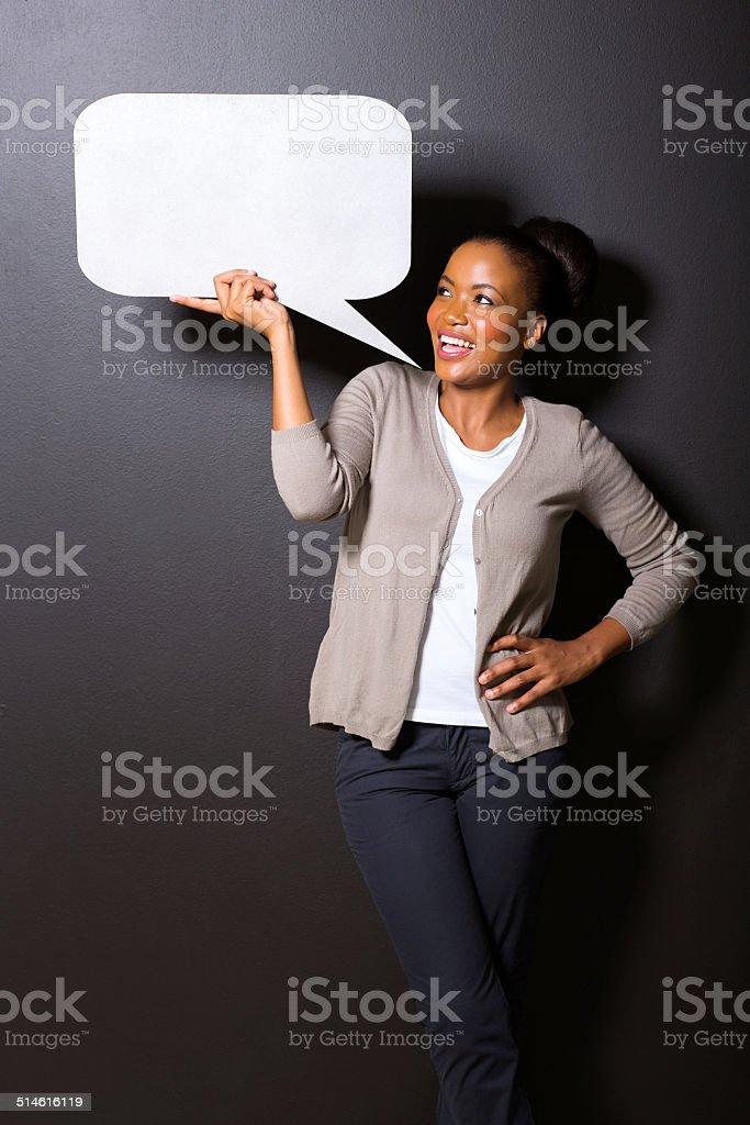 afro american woman holding speech bubble stock photo