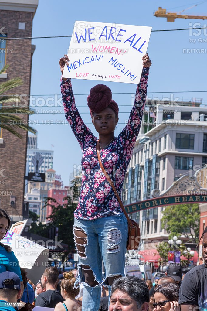 Afro American woman with sign at protest stock photo