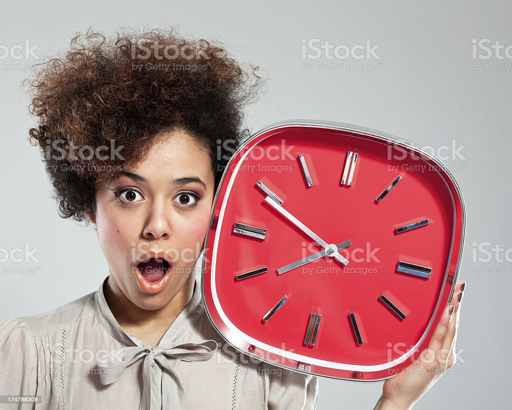 Afro Girl with Clock stock photo