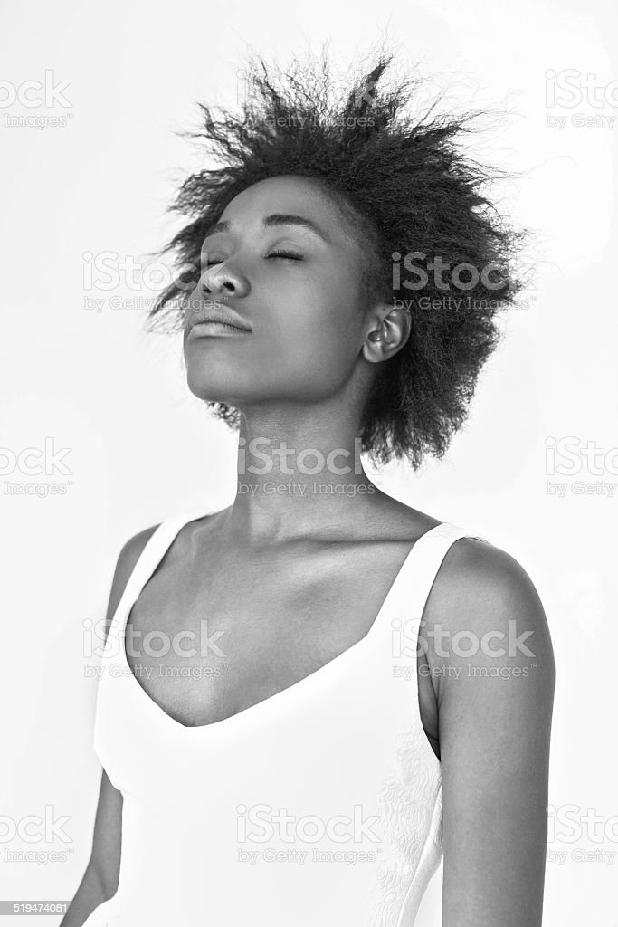Afro girl with eyes closed. stock photo