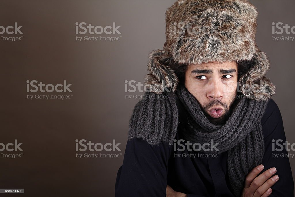 Afro man is blowing because of coldness stock photo