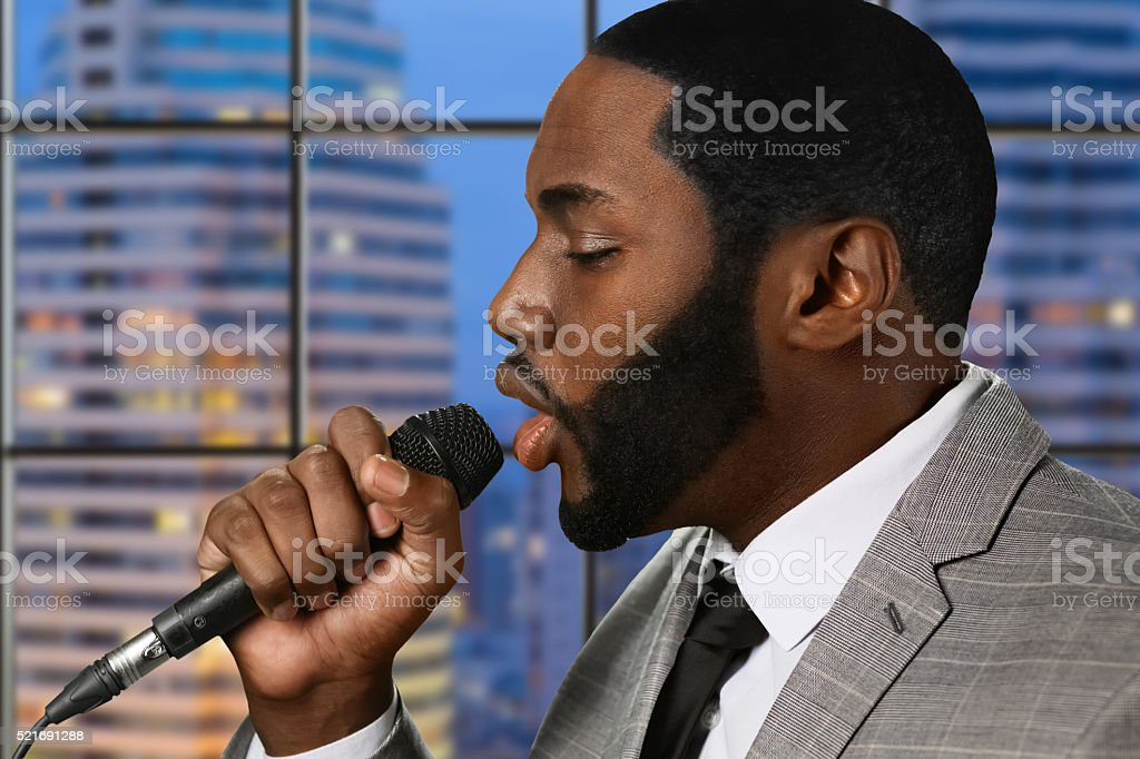 Afro singer with microphone. stock photo