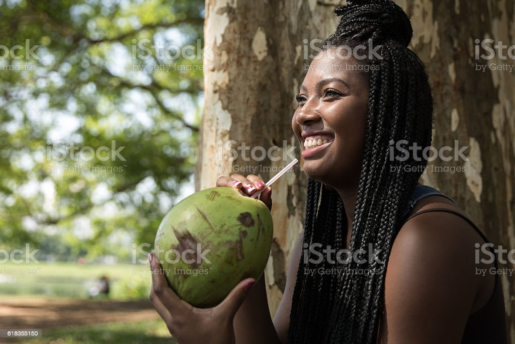 Afro young girl chilling out in the park stock photo