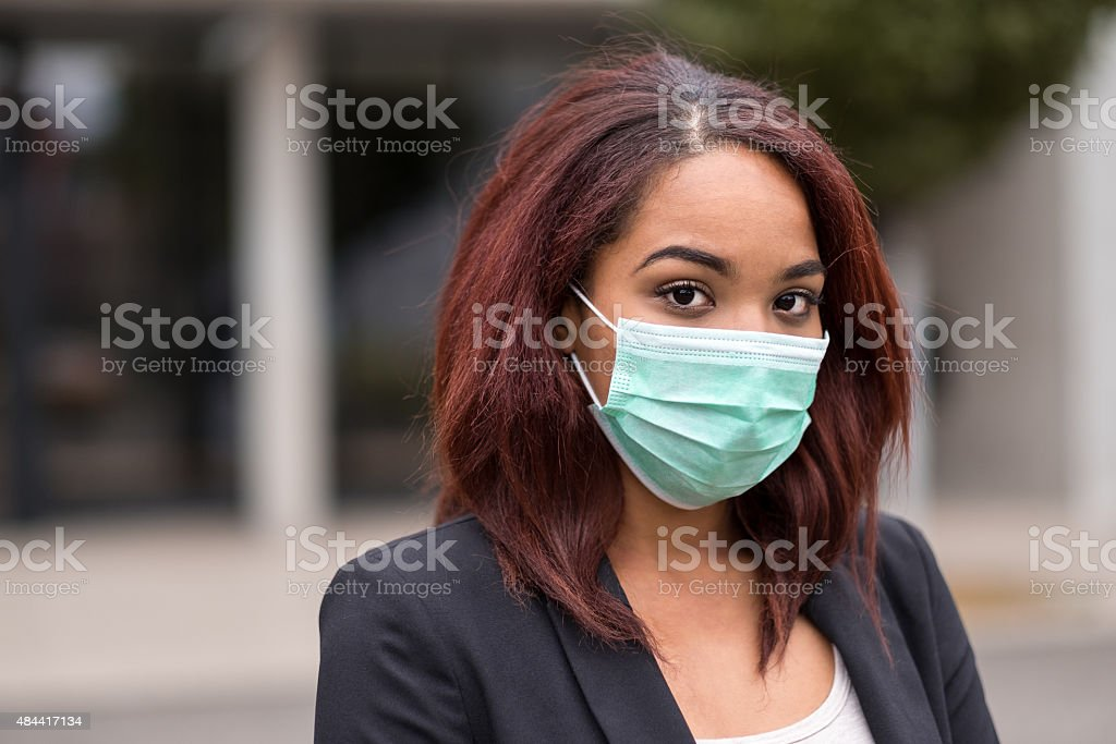 Afro-American Businesswoman Wearing Health Mask stock photo