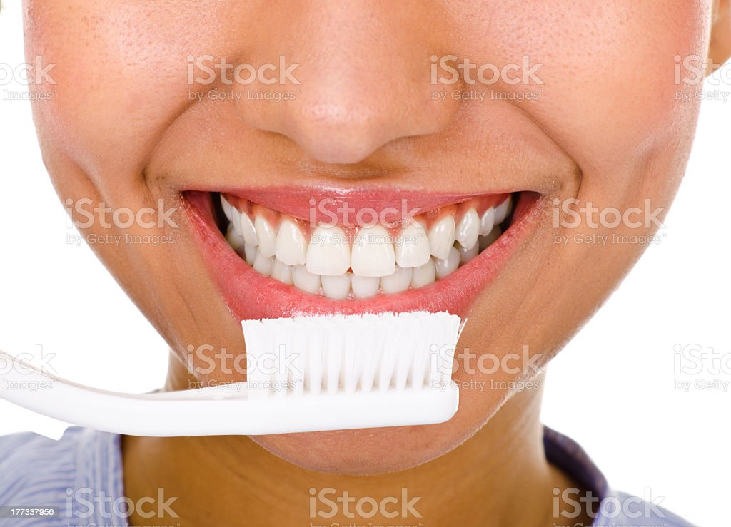 Afro-american girl brushing her teeth royalty-free stock photo