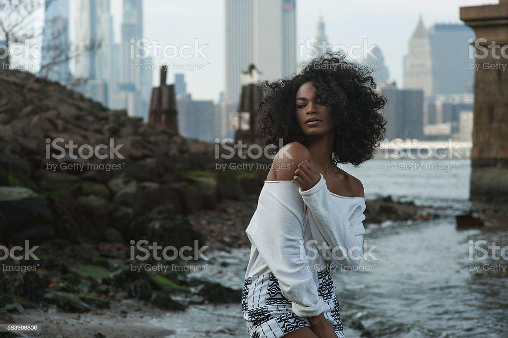 Afroamerican girl in vintage Brooklyn bridge area stock photo